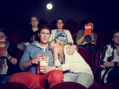scared-girl-with-her-boyfriend-in-cinema